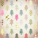 Seamless Christmas background in patchwork style. Christmas trees on vintage background Royalty Free Stock Images