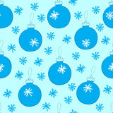 Seamless Christmas balls with the snow. Seamless texture with blue Christmas balls with snowflakes Royalty Free Stock Photography