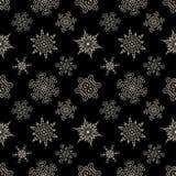 Seamless Christmas black pattern with drawn snowflakes. Seamless Christmas black pattern with random drawn snowflakes Royalty Free Stock Image
