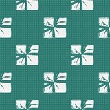 Seamless Christmas Gift Box Present Pattern. Winter Seamless Pattern with Christmas Gift Boxes. Wrapped Boxes with Stripes and Bows Flat Vector on Color Royalty Free Stock Photography