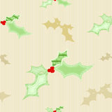 Seamless Christmas holly background Stock Photos