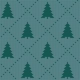 Seamless Christmas nordic knitting vector pattern with colorful fir-trees and decorative line. On light blue background Stock Photos