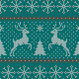 Seamless Christmas nordic knitting vector pattern with fir-trees, snowflakes, deer, snow and decorative stripes. On green background Royalty Free Stock Photography