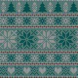 Seamless Christmas nordic knitting vector pattern with fir-trees, snowflakes, flowers or hearts. On green background Royalty Free Stock Photography