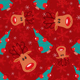Seamless christmas pattern. Rudolph, tree and snowflakes on red background Royalty Free Stock Photography