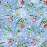 Seamless Christmas pattern/. Seamless Christmas pattern, Christmas balls, fir branches on blue background with white snowflakes Royalty Free Stock Images
