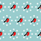 Seamless christmas pattern with bullfinches. Vector illustration. On a blue background stock illustration