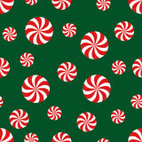 Seamless Christmas pattern with candy on green background. Royalty Free Stock Images