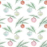 Seamless Christmas pattern, Christmas balls, fir branches on blue background with white snowflakes. Stock Photo