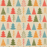Seamless Christmas  pattern with colorful fir-trees. On a beige background in a vintage style Royalty Free Stock Photo