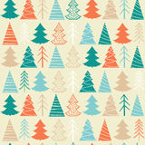 Seamless Christmas  pattern with colorful fir-trees. On a beige background in a vintage style Stock Photography