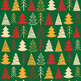 Seamless Christmas  pattern with colorful fir-trees. On a green background in a vintage style Royalty Free Stock Photo