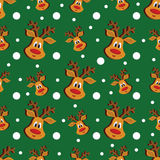 Seamless Christmas pattern with deer and snowflakes on green background. Stock Photo