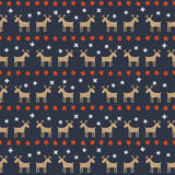 Seamless Christmas pattern - deers, stars and snowflakes. Stock Photos