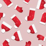 Seamless Christmas pattern. Endless texture with red hats, mittens and socks. Stock Image