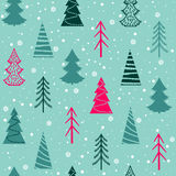 Seamless Christmas  pattern with fir-trees, snowflakes, snow. On a blue background in a vintage style Royalty Free Stock Image