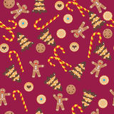 Seamless Christmas pattern with gingerbread man, cookies. And candies Royalty Free Stock Photos