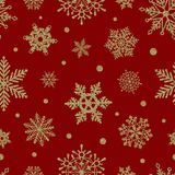 Seamless christmas pattern with gold glitter snowflakes on red background