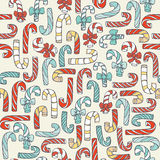Seamless christmas pattern with hand drawn candy canes in different colors. Doodles in simple graphic style. Vector decorative ill. Ustration in blue and red Stock Illustration