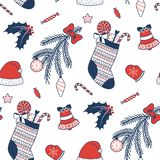Seamless Christmas pattern. Hand drawn seamless vector pattern with Christmas stocking, Santa Claus hat, decorated tree branch, sweets, bell, mitten. Design Stock Photos