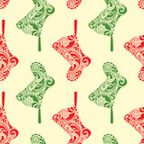 Seamless Christmas pattern with hanging Santa sock Stock Photos