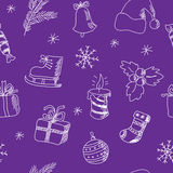 Seamless Christmas pattern on a purple background Royalty Free Stock Images