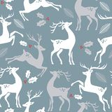 Deer on blue background with hole berries and leaves. Seamless Christmas pattern with reindeer, holy berries, leaves on blue background. illustration vector illustration