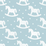 Seamless christmas pattern with rocking horses. Stock Images
