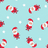 Seamless Christmas pattern with Santa Claus and stars on polka dot background. Royalty Free Stock Photo