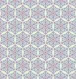 Seamless Christmas pattern with snowflakes. Geometric pattern in bright colors. Royalty Free Stock Images