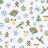 Seamless Christmas pattern with snowflakes, gingerbread men, Christmas trees, bells and another elements Royalty Free Stock Photo