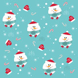 Seamless Christmas pattern with snowmen on a blue background. Royalty Free Stock Photography