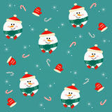 Seamless Christmas pattern with snowmen on a green background. Royalty Free Stock Photography