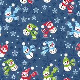 Seamless Christmas pattern with snowmen and snow-flakes Stock Image