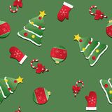 Seamless Christmas pattern. texture with red mittens, Christmas trees and candy canes Royalty Free Stock Images