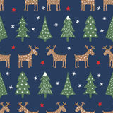 Seamless Christmas pattern - varied Xmas trees, deer, stars and snowflakes. Stock Photo