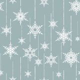 Seamless Christmas pattern. White snowflakes on light grey background. Colorful background Royalty Free Illustration