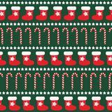 Seamless Christmas pattern with xmas socks, stars and candy canes. Happy New Year and Merry Xmas background. Vector design for winter holidays on dark green Stock Image