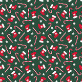 Seamless Christmas pattern with xmas stocking, stars and candy canes.  Royalty Free Stock Images