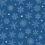 Seamless Christmas snowflakes Stock Images