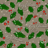 Seamless Christmas texture with holly leaves. Stock Photos