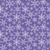 Seamless christmas texture with snowflakes on a blue background royalty free illustration