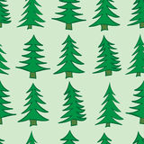 Seamless Christmas trees. Seamless texture with coniferous fir-trees on a green background Royalty Free Stock Photo