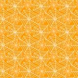 Seamless cobwebs on orange background. Orange background with white spider cobweb pattern Stock Image