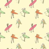 Seamless color pattern with girls with surf boards walking along the beach. Royalty Free Stock Photos