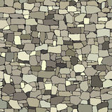 Seamless colored background wall from stones of various sizes. Stock Images