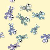 Seamless colored bunny pattern with ball on yellow Royalty Free Stock Image