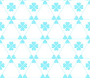 Seamless colored pattern. Print of blue color clovers four and three leaves and lines of triangles on white background. Stock Photography