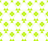 Seamless colored pattern. Print of light green color clovers four and three leaves and lines of triangles on white background. Seamless colored pattern. Print Stock Photo