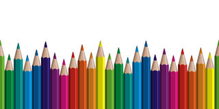 Seamless colored pencils row. With wave on lower side Stock Photos